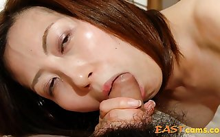 Japanese MILF Licks with an increment of Sucks Flannel